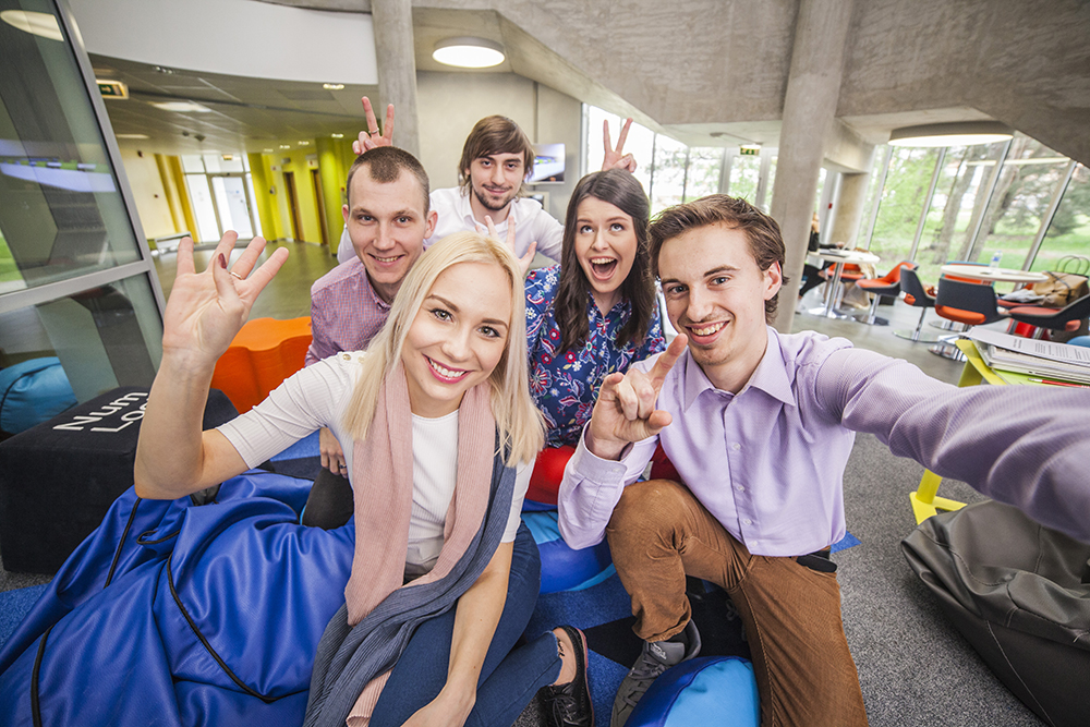 A group of five students cheering about the EuroTeQ Campus